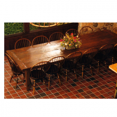 Four board wide plank dining room table with breadboard ends.