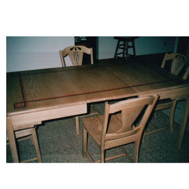 Recreated bleach blond finish and created an art deco style design on an art deco dining room table and chairs.