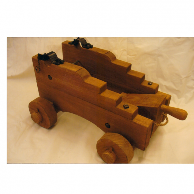 Replica Cannon Carriage made from White Oak. Hand hammered hardware. Created patina from chemicals on metal and wood.